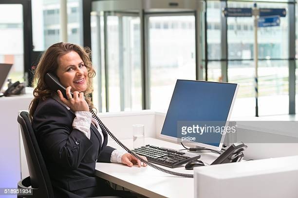 Cheerful front desk lady doing her job with passion