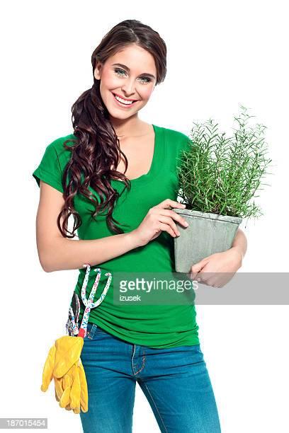 Cheerful gardener with herbs
