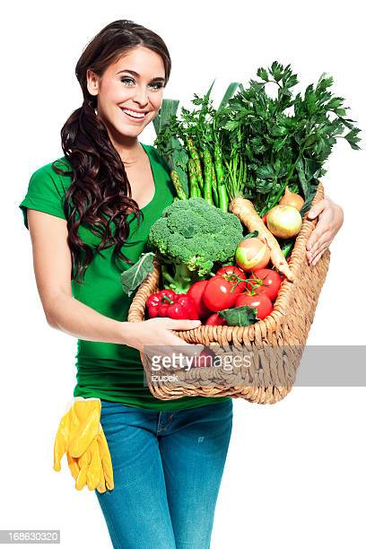 Cheerful gardener with vegetables