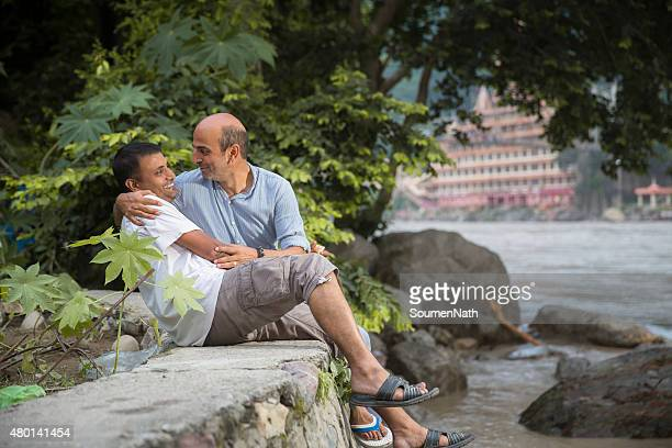 Cheerful Gay couple sharing a loving moment together