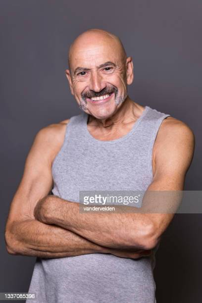 cheerful gay man in his seventies - one senior man only stock pictures, royalty-free photos & images