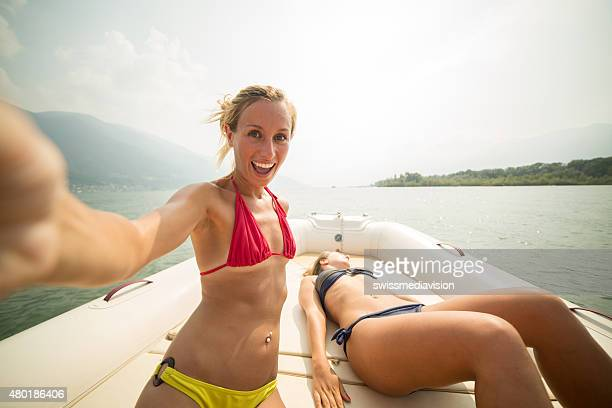 Cheerful girl capturing summer selfie