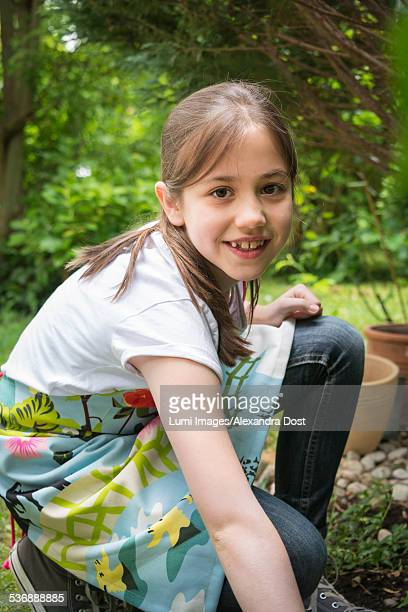 cheerful girl gardening, portrait - alexandra dost stock-fotos und bilder
