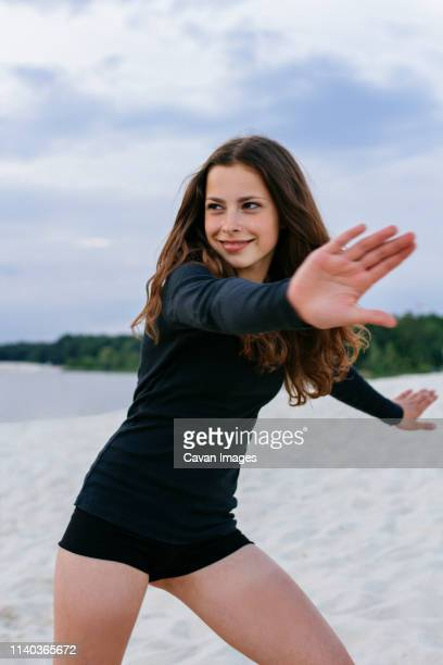cheerful girl on the beach in motion - marque de bronzage photos et images de collection