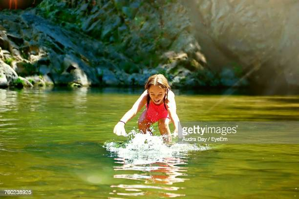 cheerful girl playing in lake at big basin redwoods state park - big basin redwoods state park stock pictures, royalty-free photos & images