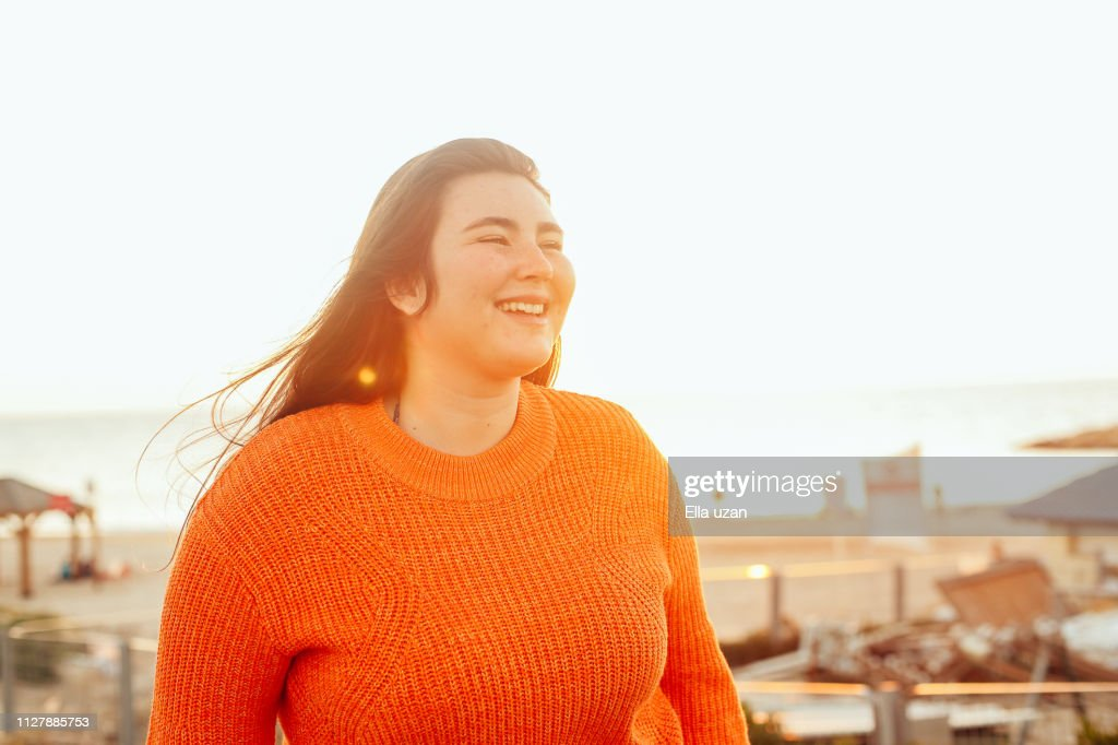 Cheerful girl walking outdoors : Stock Photo