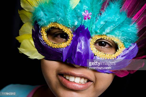 cheerful girl with a mask - mardi gras girls stock photos and pictures