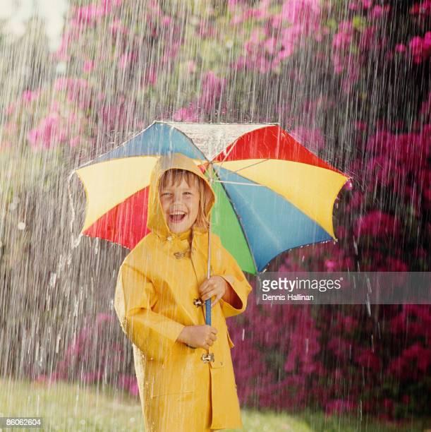 Cheerful girl with an umbrella