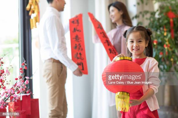 Cheerful girl with traditional lantern
