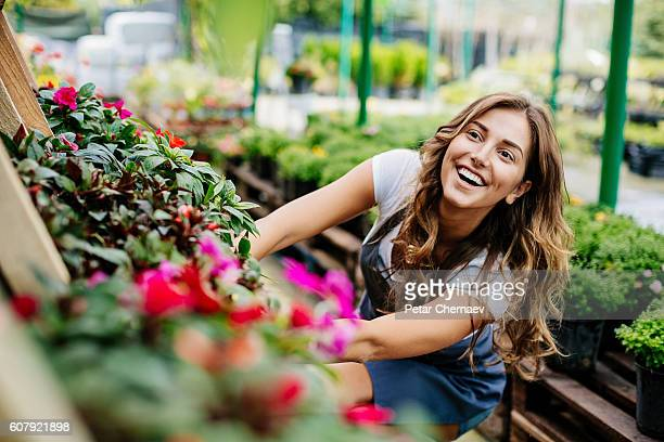 Cheerful girl working with flowers