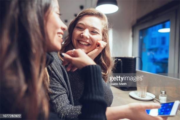 Cheerful girlfriends having a coffee break.