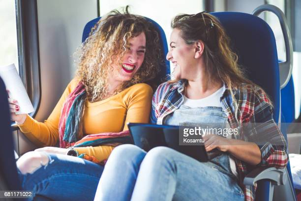 Cheerful Girlfriends Laughing In Train