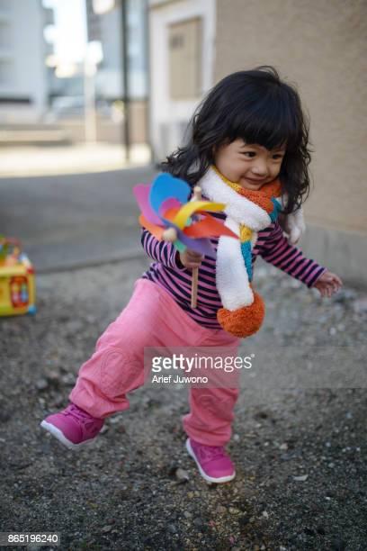 cheerful girls play around the house