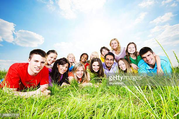 Cheerful group lying in the nature.