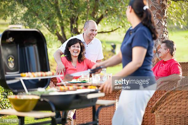 Cheerful group of friends having a barbecue