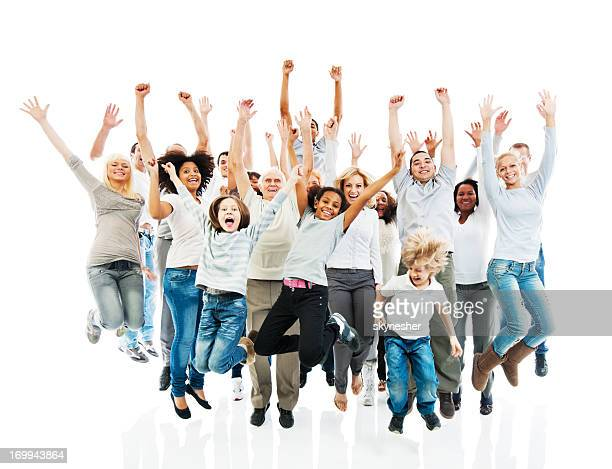 Cheerful group of people jumping with raised hands.