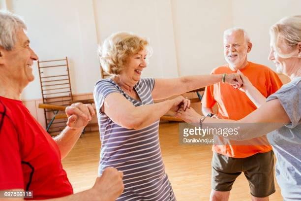 cheerful group of seniors practice dancing together and having fun - dance studio stock pictures, royalty-free photos & images