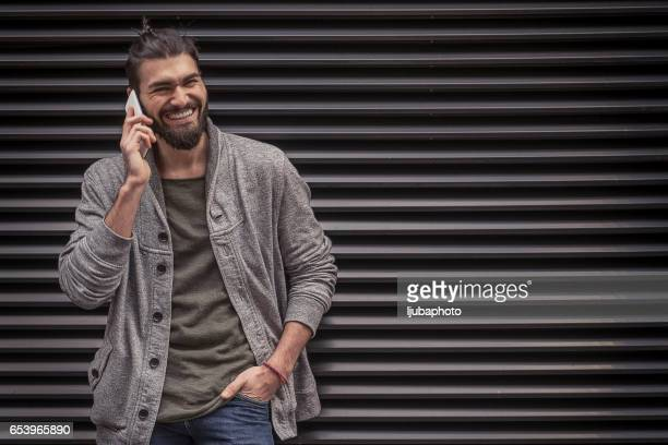 Cheerful handsome  man talking on mobile phone