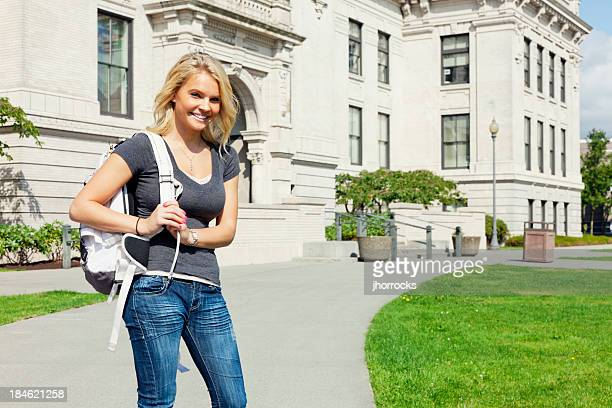 Cheerful Highschool Student on Campus with Backpack