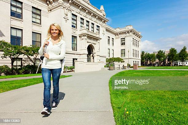 Cheerful Highschool Student Walking on Campus