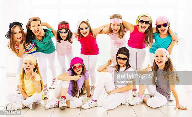 cheerful hip hop dance group. - dance troupe stock photos and pictures