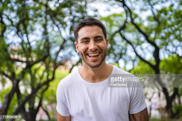 cheerful hispanic man looking at the camera - argentina stock pictures, royalty-free photos & images