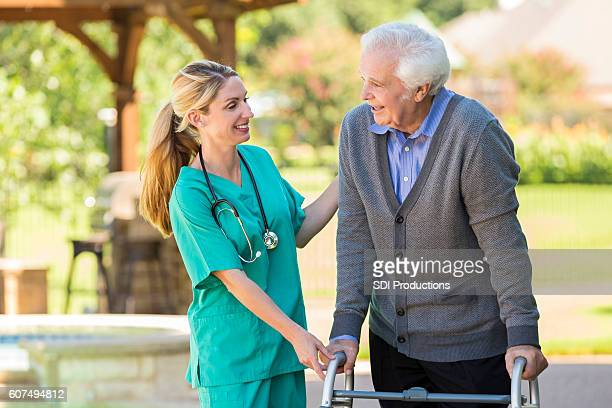 Cheerful home healthcare nurse takes care of senior patient