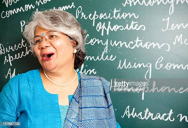 cheerful indian asian woman english teacher in classroom with greenboard - salwar kameez stock pictures, royalty-free photos & images
