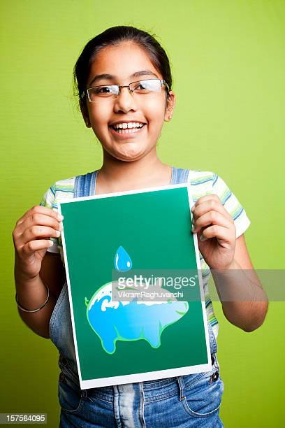 Cheerful Indian Girl Making an Appeal to Save Water