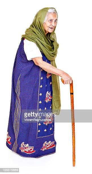 Cheerful Indian Senior Aged Woman with Walking Stick Full Length