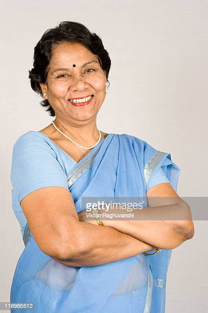 Cheerful Indian Senior Business Woman Hands Folded