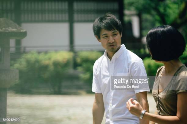 cheerful japanese couple at the temple, front view - lypsekyo16 stock pictures, royalty-free photos & images