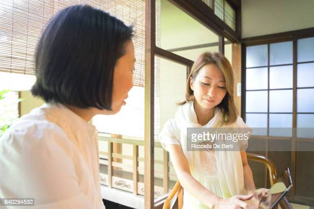 Cheerful Japanese women having a meeting in a tea house
