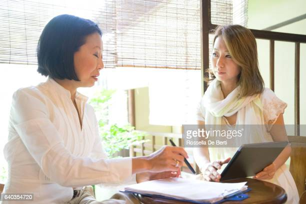 cheerful japanese women having a meeting in a tea house - adult videos japan stock pictures, royalty-free photos & images