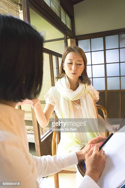cheerful japanese women having a meeting in a traditional cafè - adult videos japan stock pictures, royalty-free photos & images