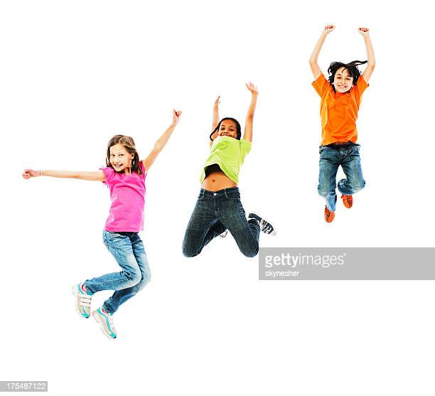 Cheerful kids jumping with arms up.