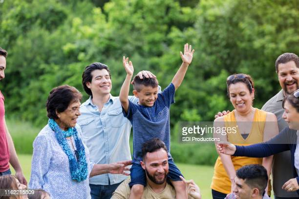 cheerful large family - family reunion stock pictures, royalty-free photos & images