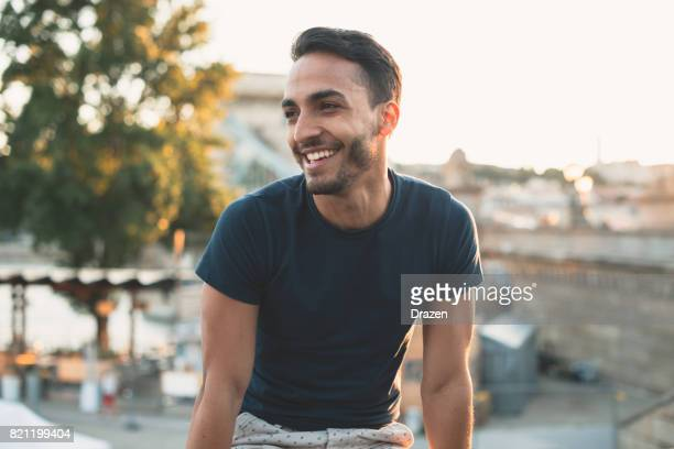 cheerful latin man traveling around europe - 20 29 years stock pictures, royalty-free photos & images