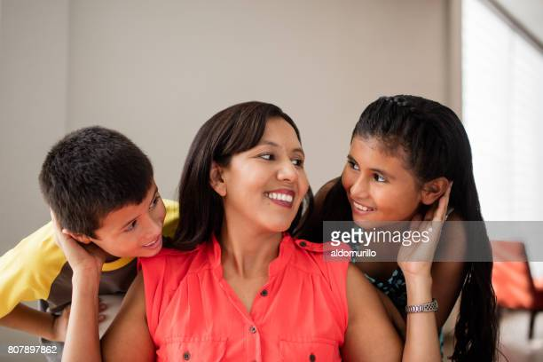cheerful latin mother with her son and daughter - mexican mom stock photos and pictures