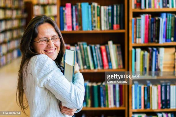 cheerful librarian. are books part of your life? be a librarian. - learning disability stock pictures, royalty-free photos & images