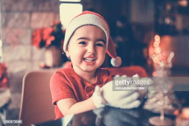 Cheerful Little Christmas Girl Enjoy In Living Room Decoration