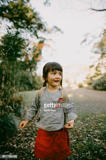 Cheerful little girl exploring nature