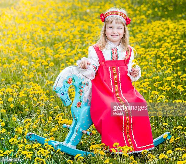 cheerful little girl on dandelion meadow - little russian girls stock photos and pictures