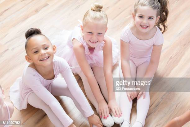 Cheerful little girls take ballet class together