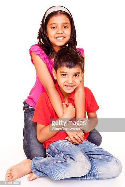 cheerful little indian brother sister sitting isolated on white - little girls bare bum stock pictures, royalty-free photos & images