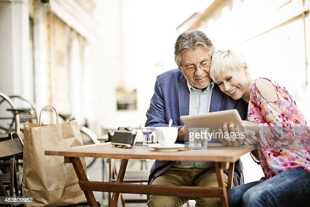 Cheerful, loving  mature couple at the Coffeehouse