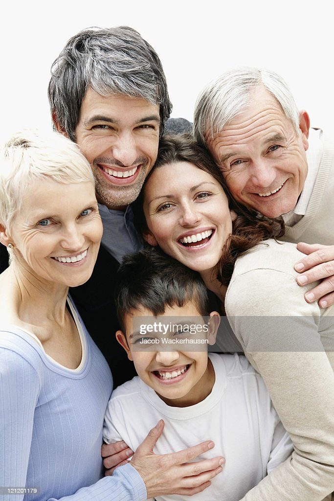 Cheerful loving multi generational family smiling together : Stockfoto