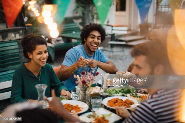 cheerful male and female friends enjoying during dinner party in backyard - ready to eat stock pictures, royalty-free photos & images