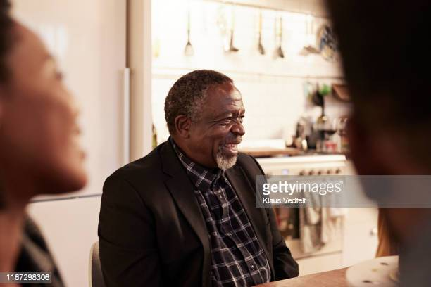 cheerful man enjoying birthday party at home - selective focus stock pictures, royalty-free photos & images