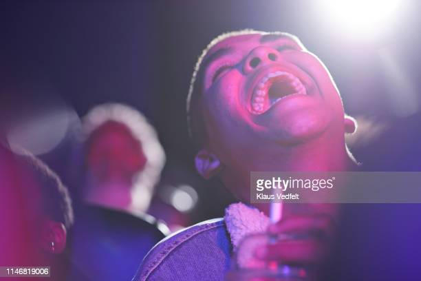 cheerful man enjoying in theater - arts culture and entertainment stock pictures, royalty-free photos & images